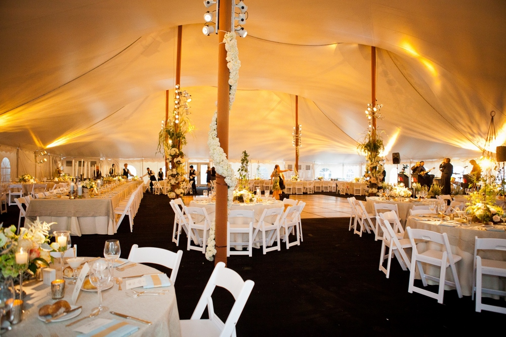 Randomly mixed rectangle and round tables in a wedding tent