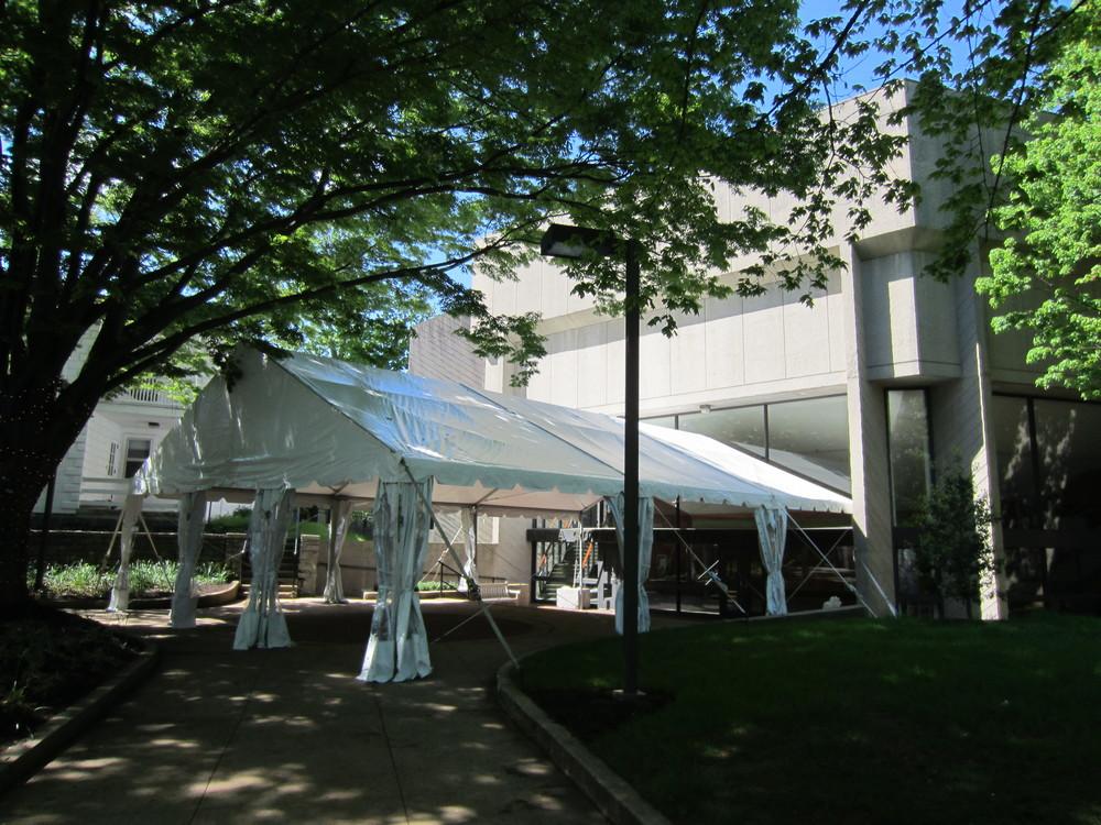 Tent as on a concrete building entranceway