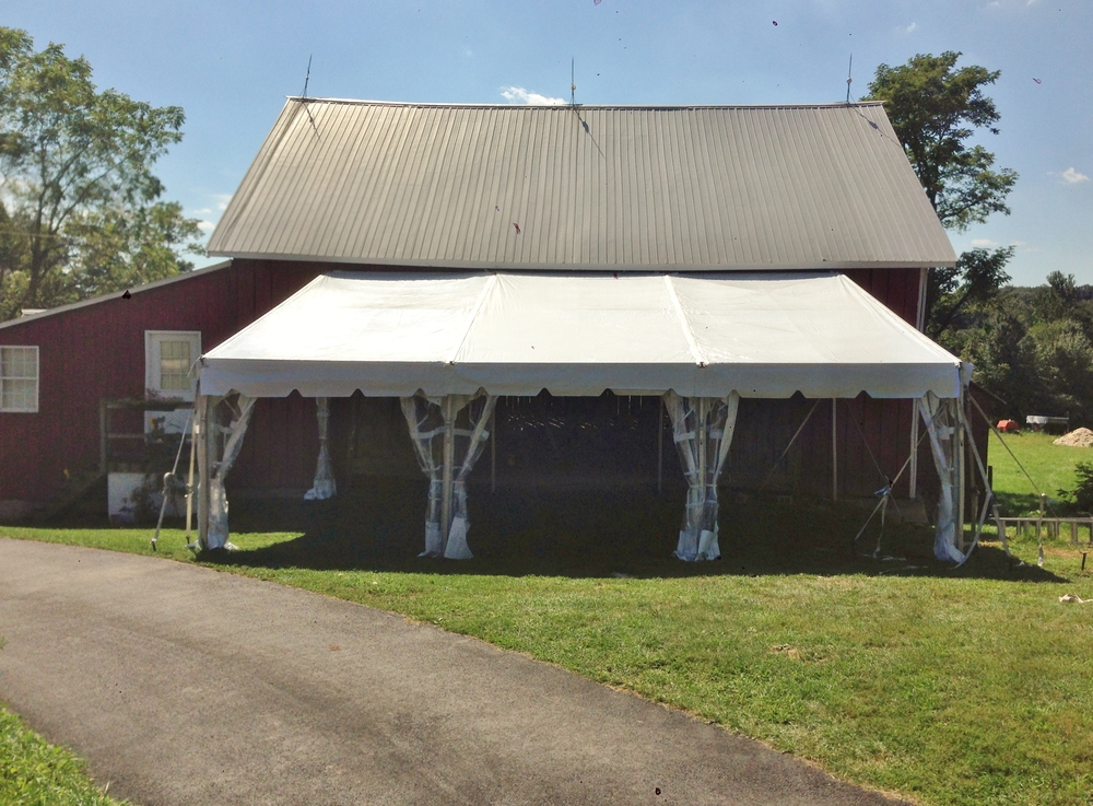 Tent connected to a barn