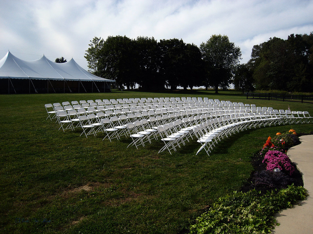 Chairs and tent for outdoor wedding