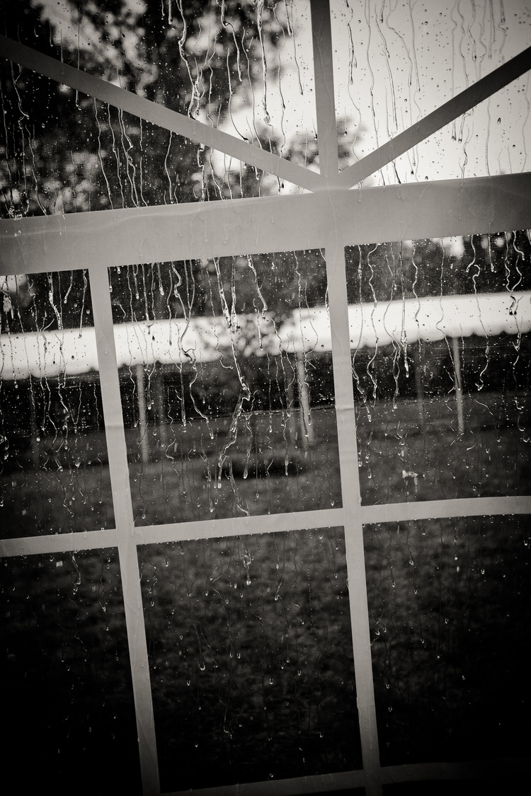 Rain on a tent window during the wedding