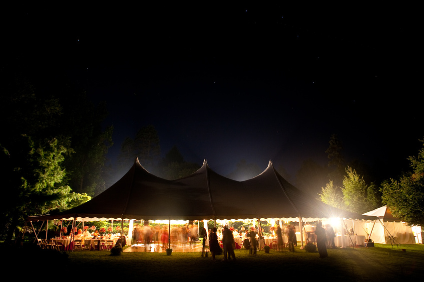 Night time wedding tent with stars visible.