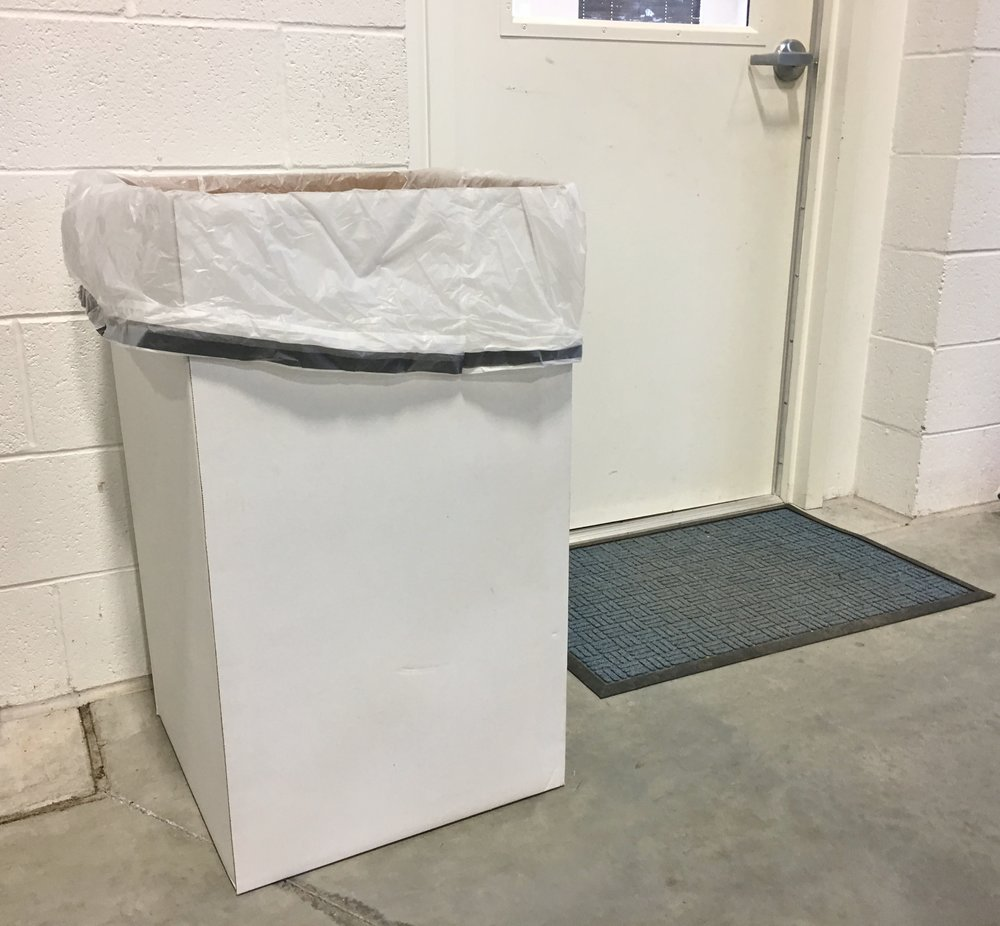 Cardboard disposable trash can with 55 gallon liner