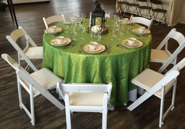 Round table with white padded garden chairs