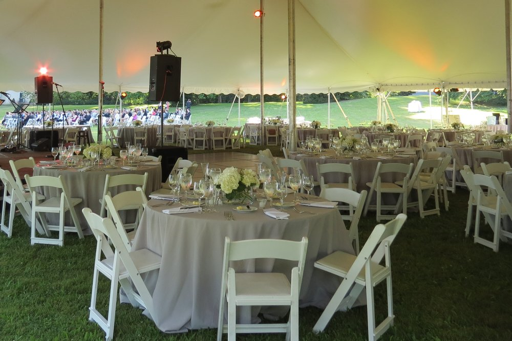 Round tables in a tent