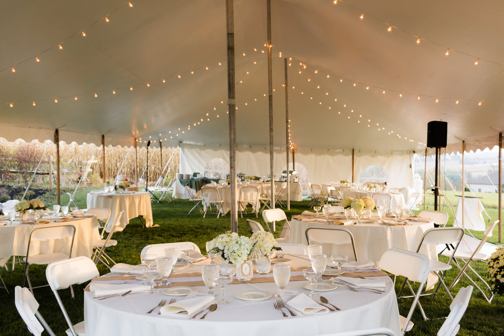 Round tables in a wedding tent