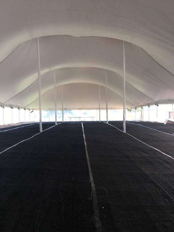 Black carpet in outdoor event tent