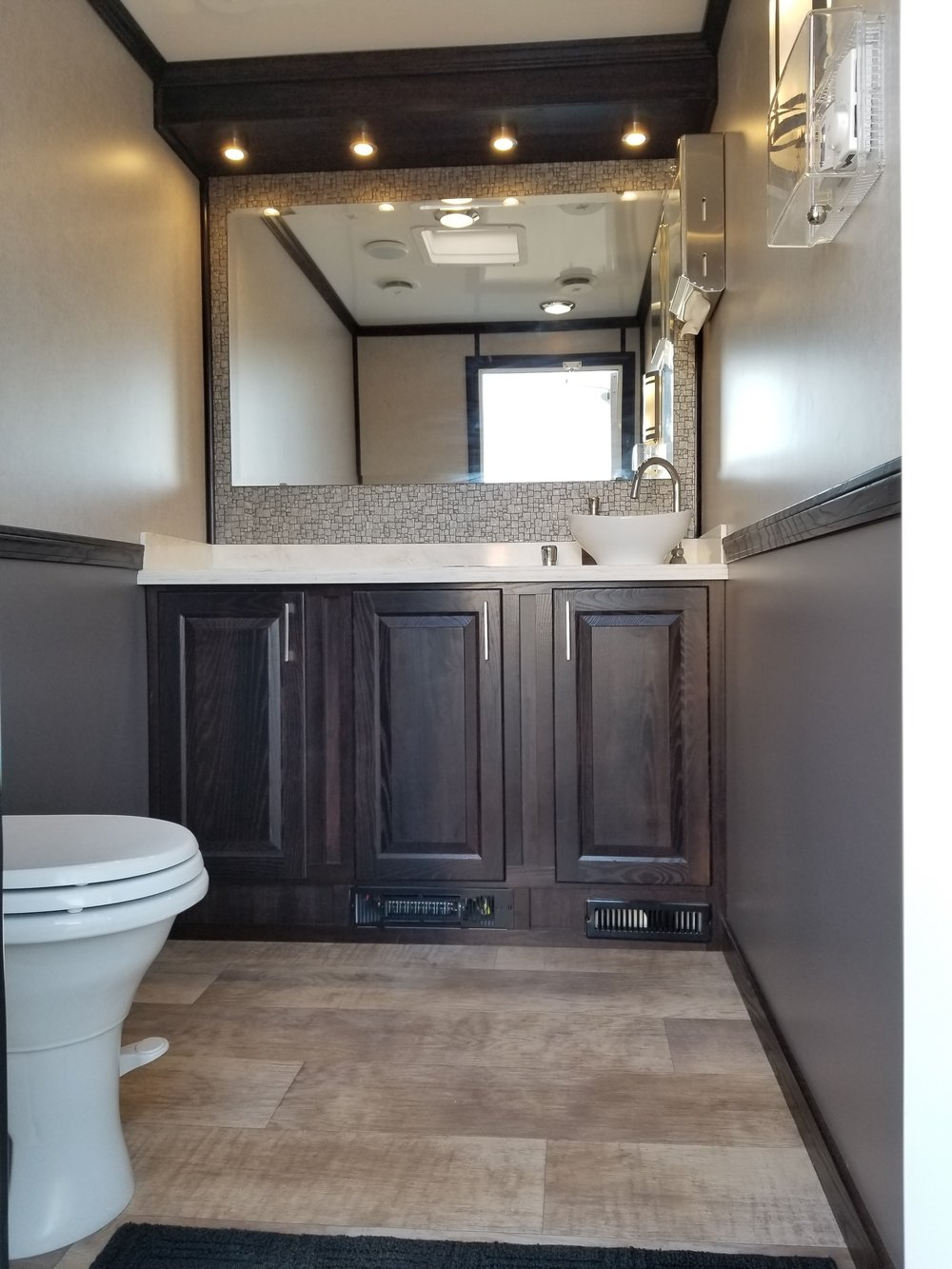 Women's side of 2 person portable restroom trailer
