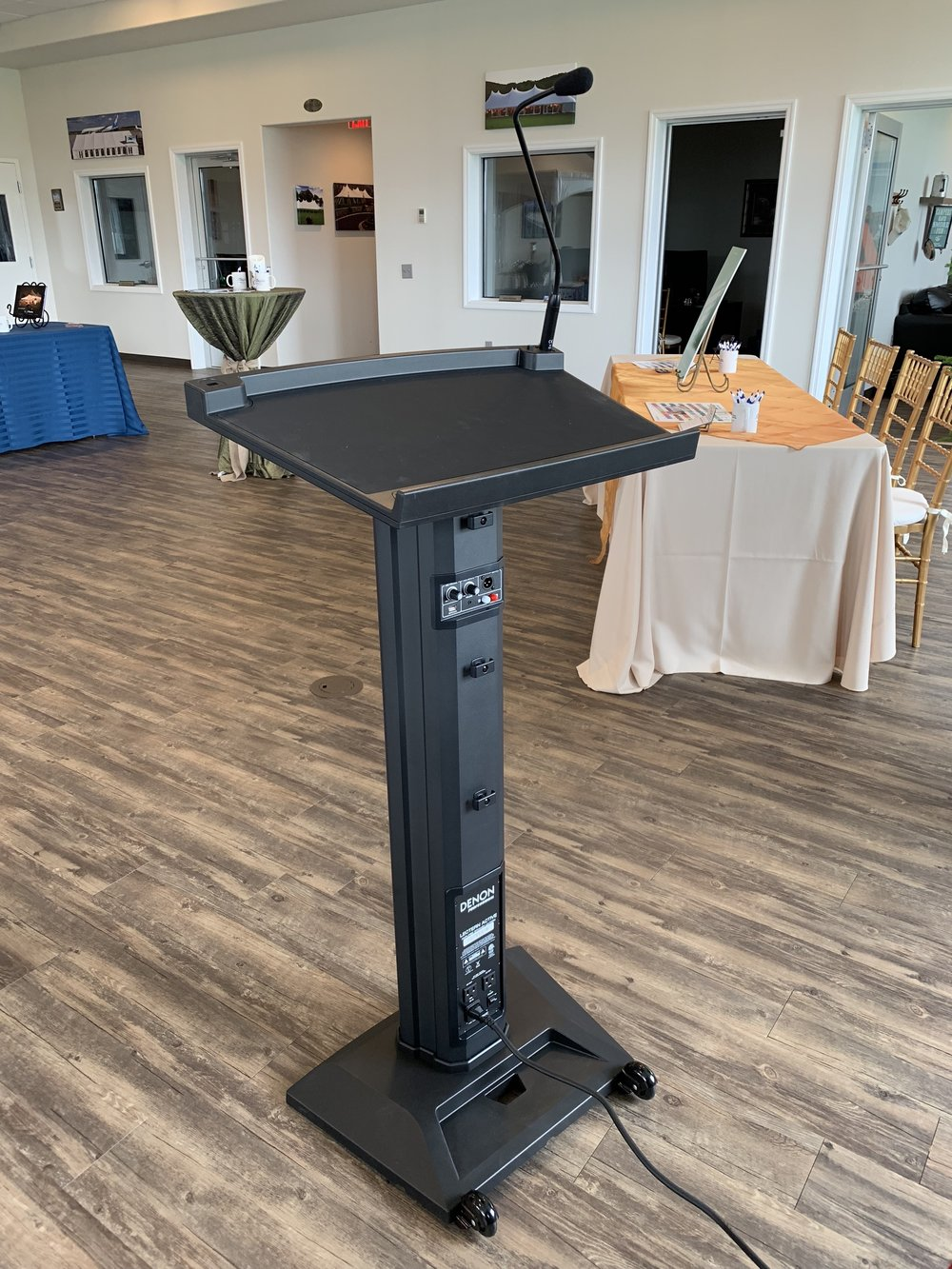 Portable podium with speaker