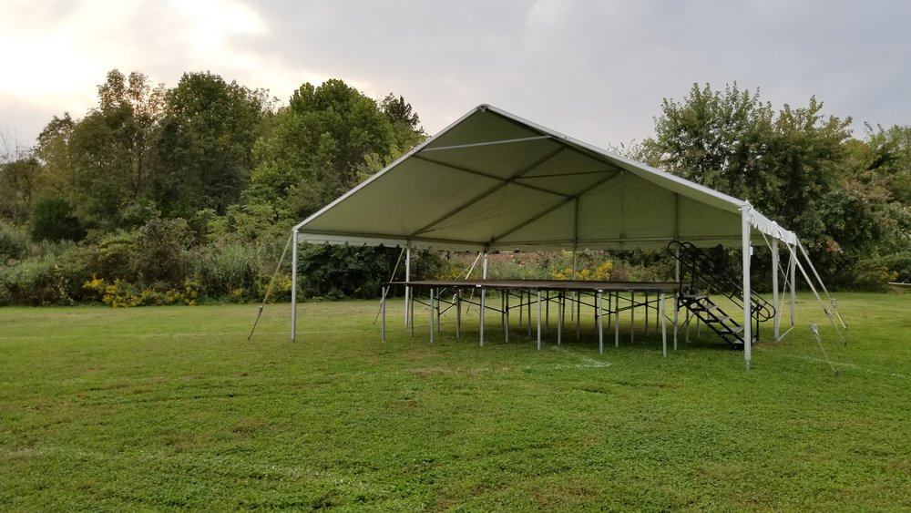 30' x 30' white frame tent with open gable and stage inside