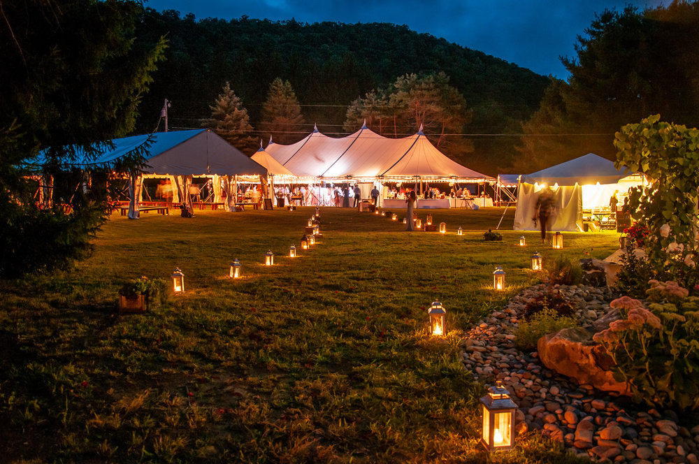 Outdoor wedding in a rustic sailcloth tent