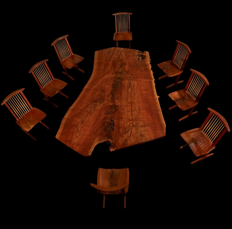 The exceptional Holtz dining table and eight Conoid chairs.