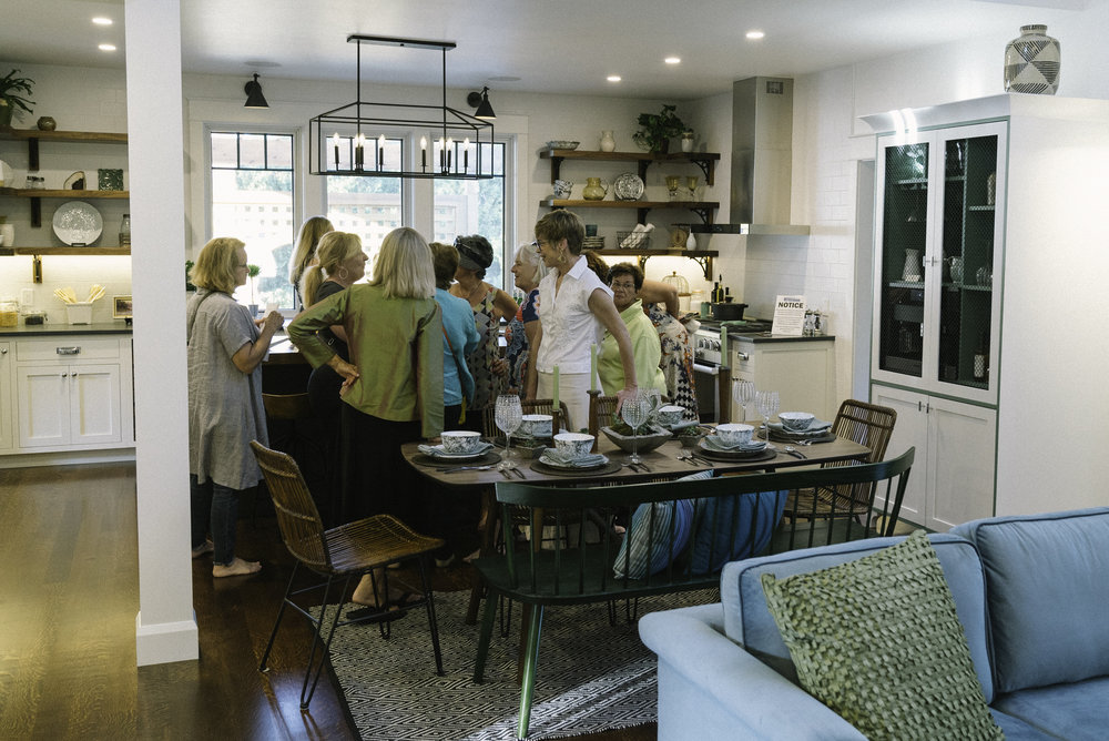 Gathering of guests in the kitchen