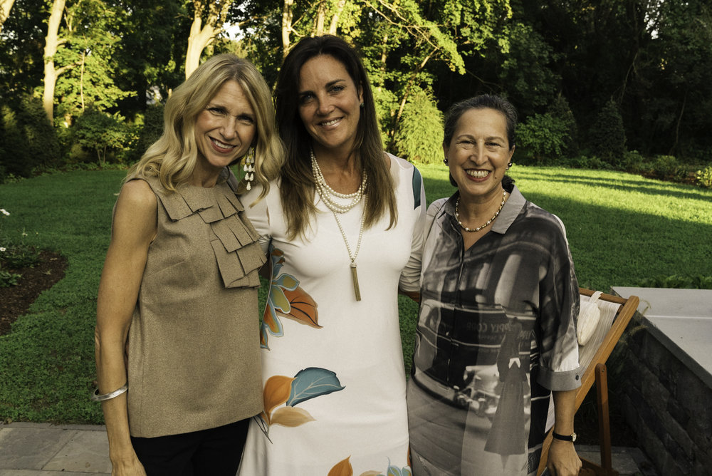 Gallerist Jessica Hagen, Interior Designer Kristen Martone, and Photographer Elizabeth Kahane on the back patio (left to right)