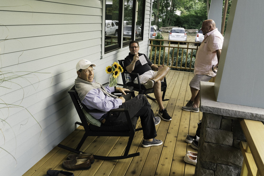 Bill Kahane and guests enjoy the front porch