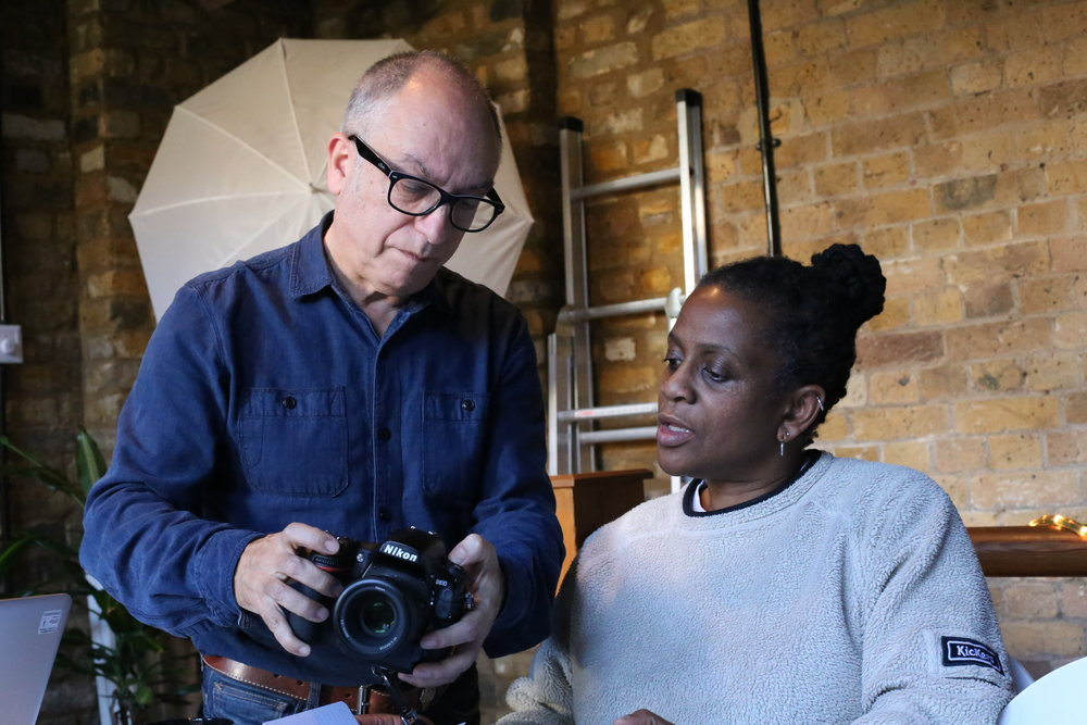 Tutor Gary Perlmutter with a student learning DSLR skills