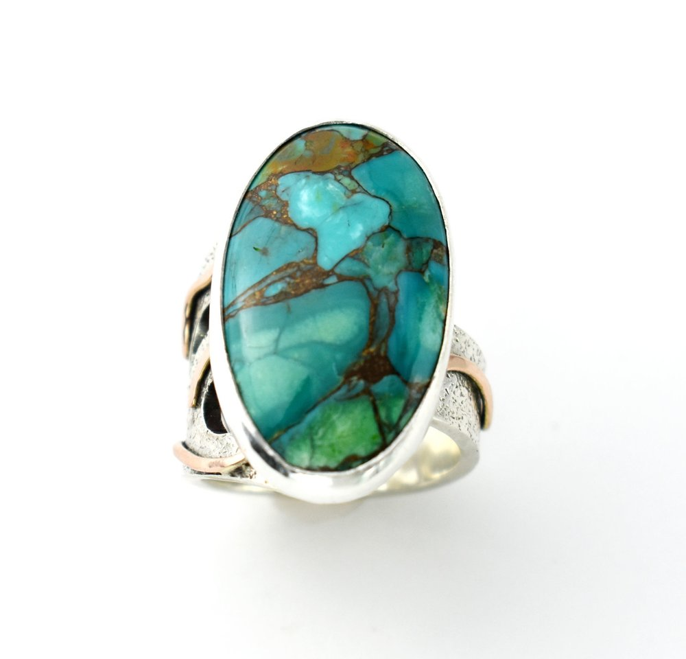 Copper River - Sterling Silver Turquoise with Copper Adjustable Ring with 14k Pink Gold AccentsSterling Silver = 10.03 dwt14k Pink Gold = 0.48 dwtTurquoise with Copper = 19.92