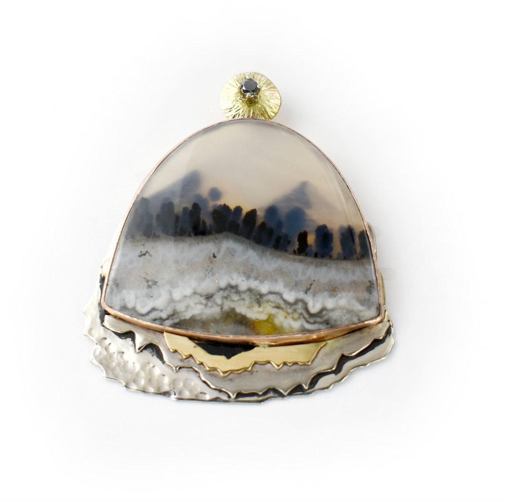 2-tone agate mountain scene with sapphire pendant.jpg