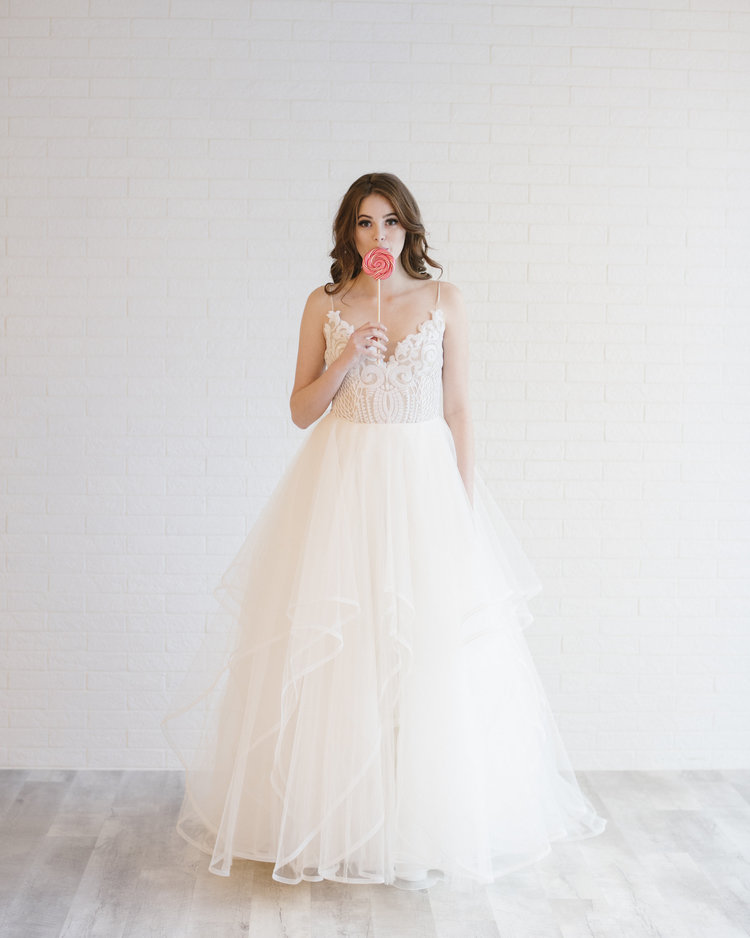 Visit our bridal shops in Edmonton and Calgary to see this wedding dress in person - .