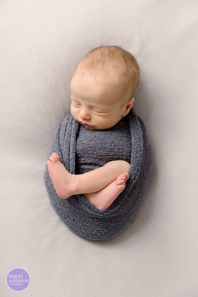 Newborn photos St Albans - wrapped up legs out