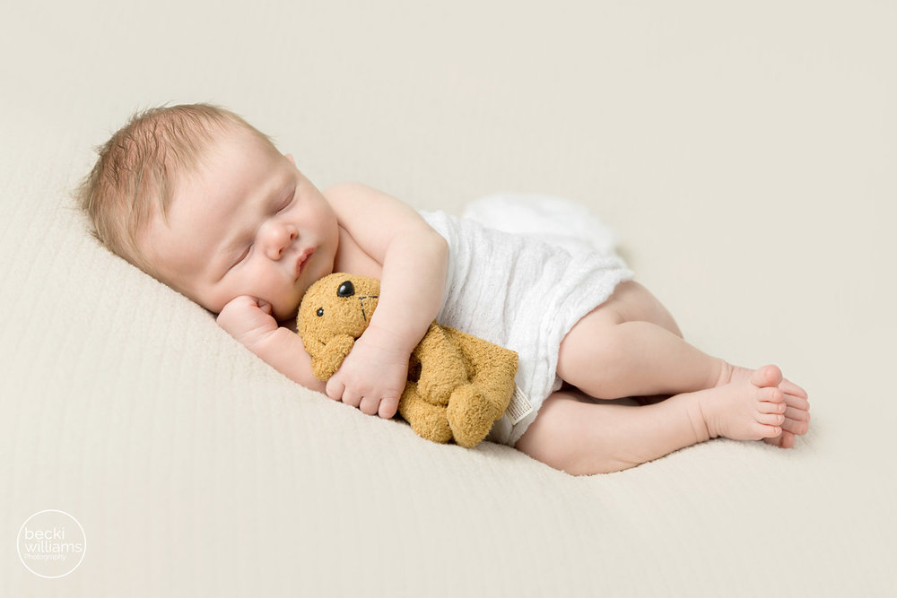 Newborn pictures hemel hempstead - asleep newborn boy cuddles his teddy