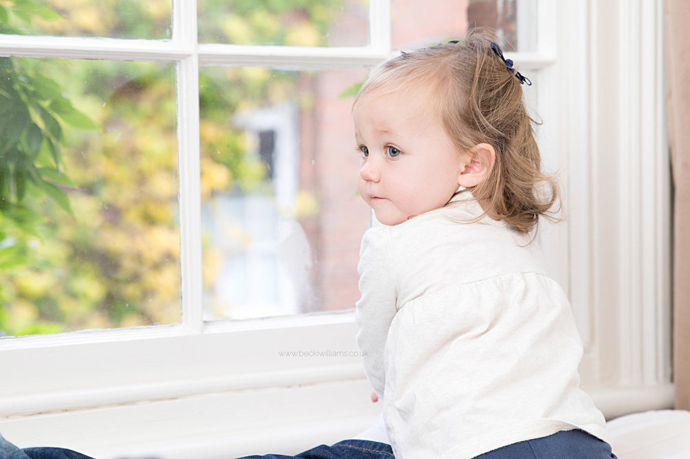 Little girl looking out of a window, St Albans
