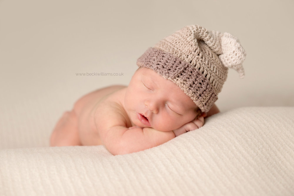 Newborn Photography hemel hempstead - sleeping baby - hat or not hat