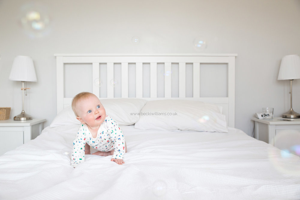 Baby-photography-hemel-hempstead-on-bed-bubbles-at-home