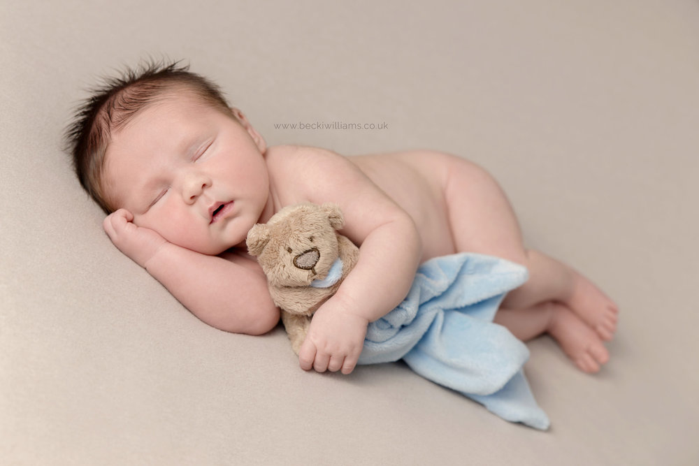 Newborn pictures in hemel hempstead - naked newborn hugs teddy