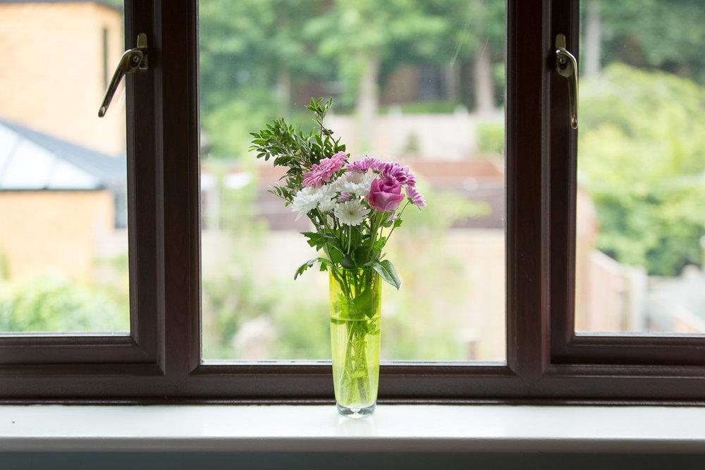 Flowers from sainsburys woodhall farm, hemel hempstead on a windowsill