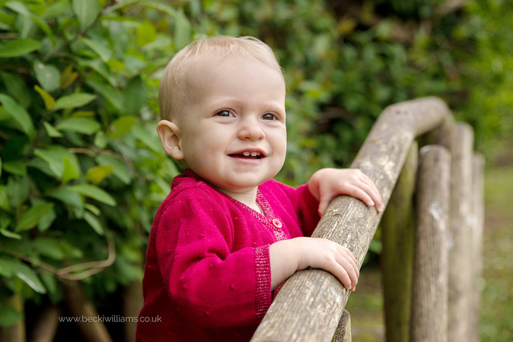 1 year old in her garden for professional photo shoot