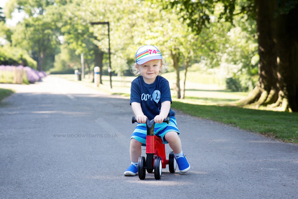 professional photography of 2 year old boy on his bike in gadebridge park, hemel hempstead