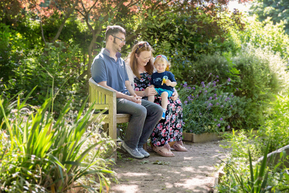 professional photography of 2 year old boy with his family in gadebridge park, hemel hempstead