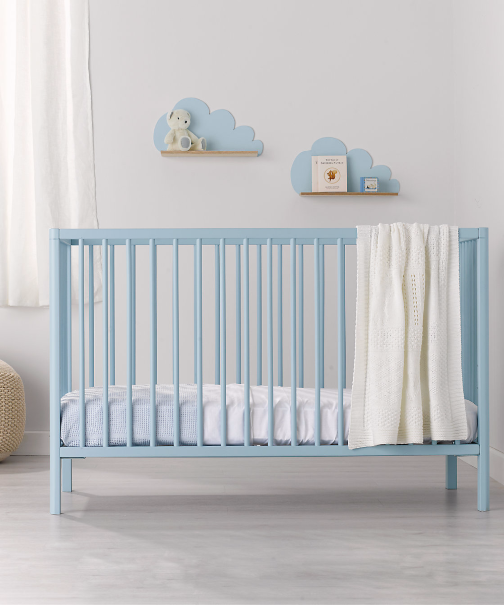 blue colourful cot from mothercare