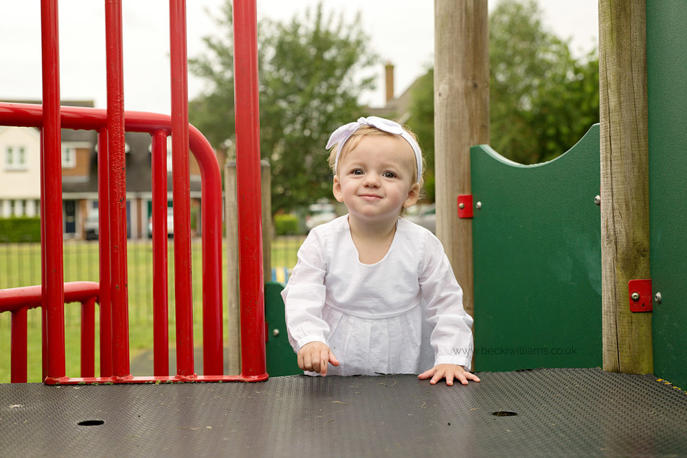 1 year old playing in a park in pirton for photo shoot