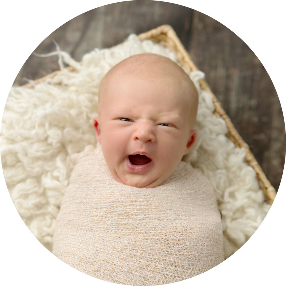 yawning newborn baby at newborn photo shoot in hemel hempstead