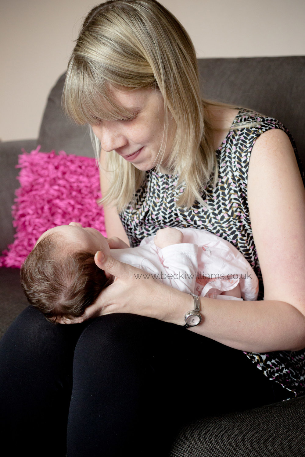 new mum hold her newborn in the living room