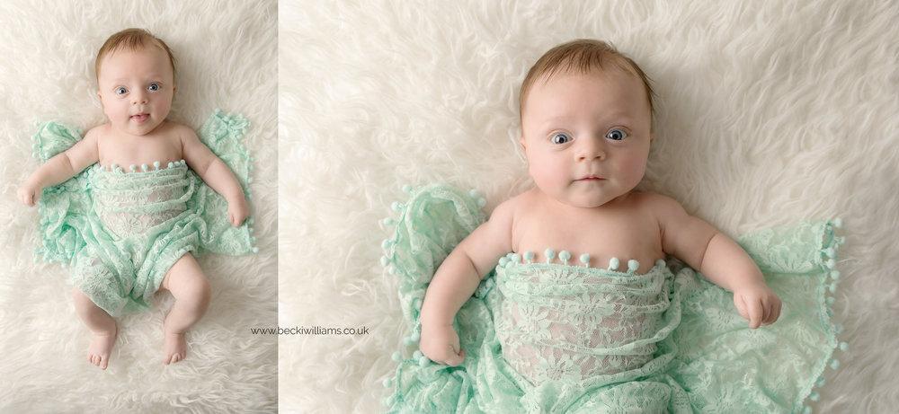 7 week old baby girl laying awake white a green blanket on her during her photo shoot in hemel hempstead