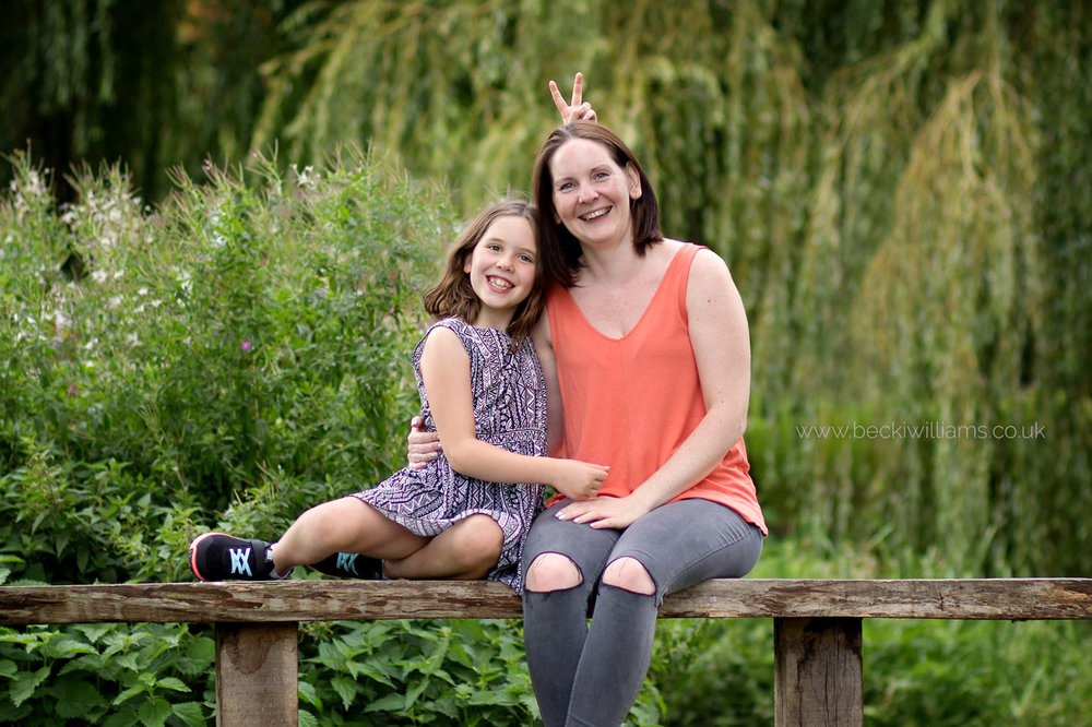 mum and daughter sit on park bench in gadebridge park, hemel hempstead