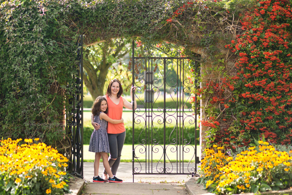 mum and daughter in walled garden in gadebridge park, hemel hempstead