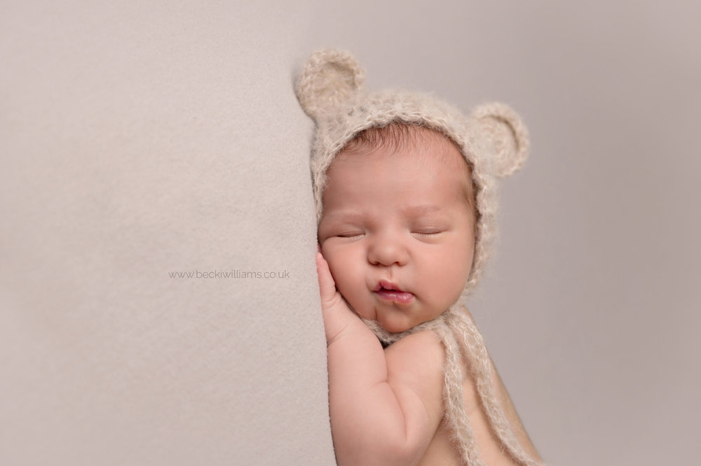 newborn-photography-hemel-hempstead-hertfordshire-studio-posed-asleep-cute-bear-hat.jpg
