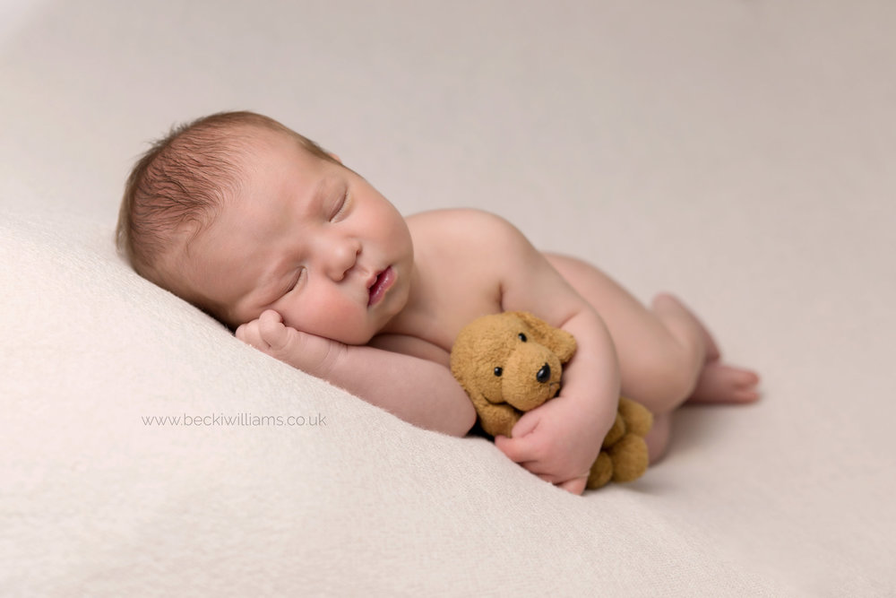 newborn-photography-hemel-hempstead-hertfordshire-studio-posed-sleeping-asleep-with-teddy-dog.jpg