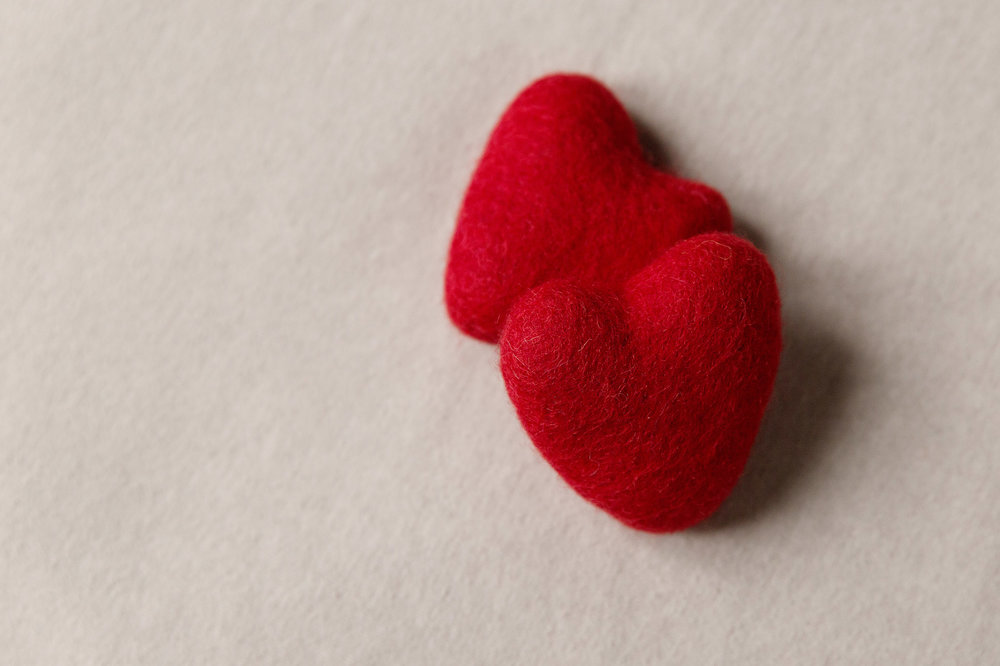 newborn-photos-st-albans-props-red-hearts.jpg
