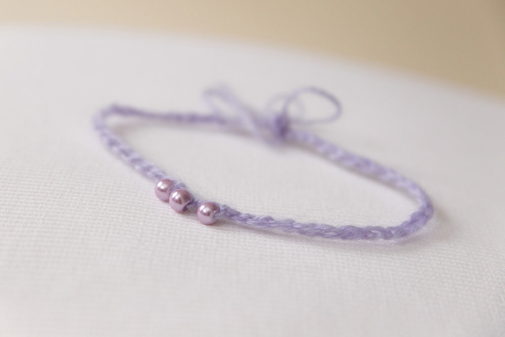 newborn-photos-st-albans-props-purple-bead-headband.jpg