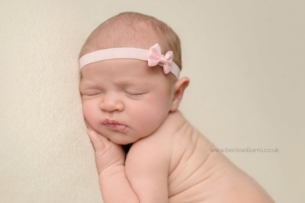 newborn-photo-shoot-hemel-hempstead-asleep-pink-headband.jpg