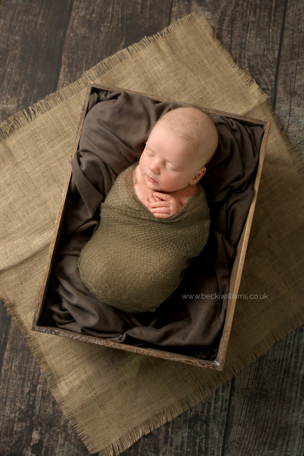 newborn-photography-hemel-hempstead-crate-brown-wrapped-sleeping.jpg