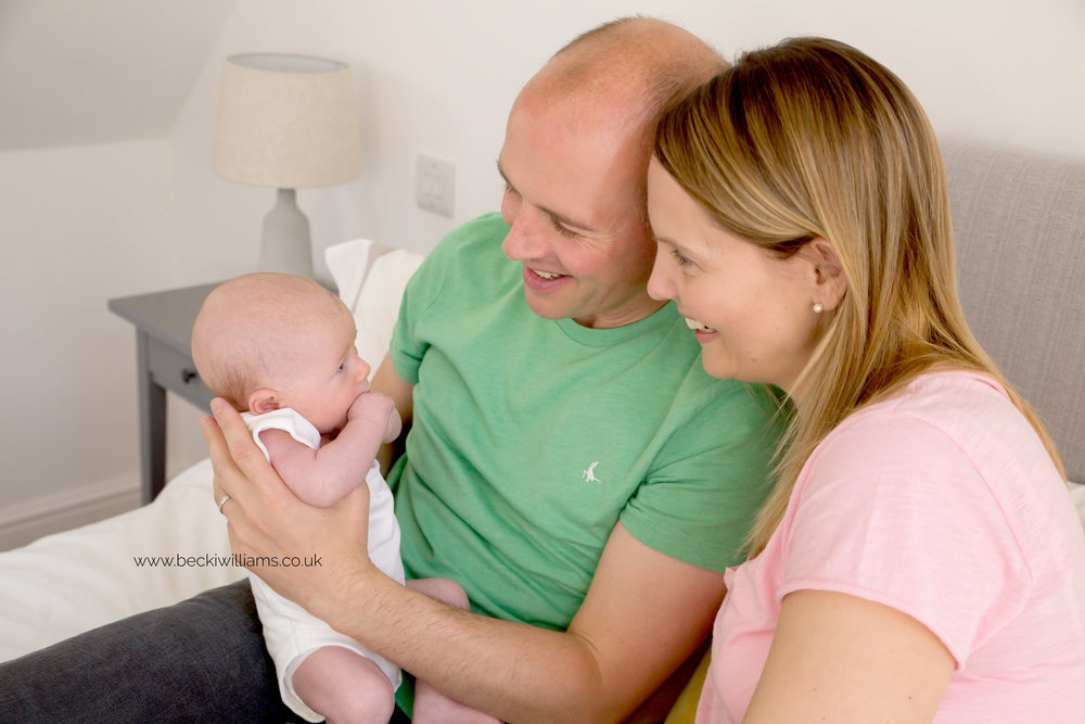 lifestyle-newborn-photography-relaxed-at-home-family-on-bed-parents.jpg