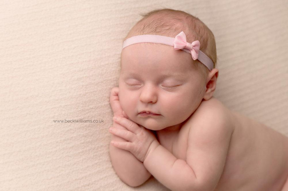 newborn-photography-st-albans-pink-headband-asleep-cute.jpg