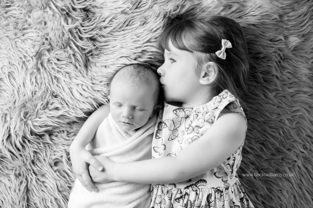newborn-photography-berkhamsted-sibling-sister.jpg
