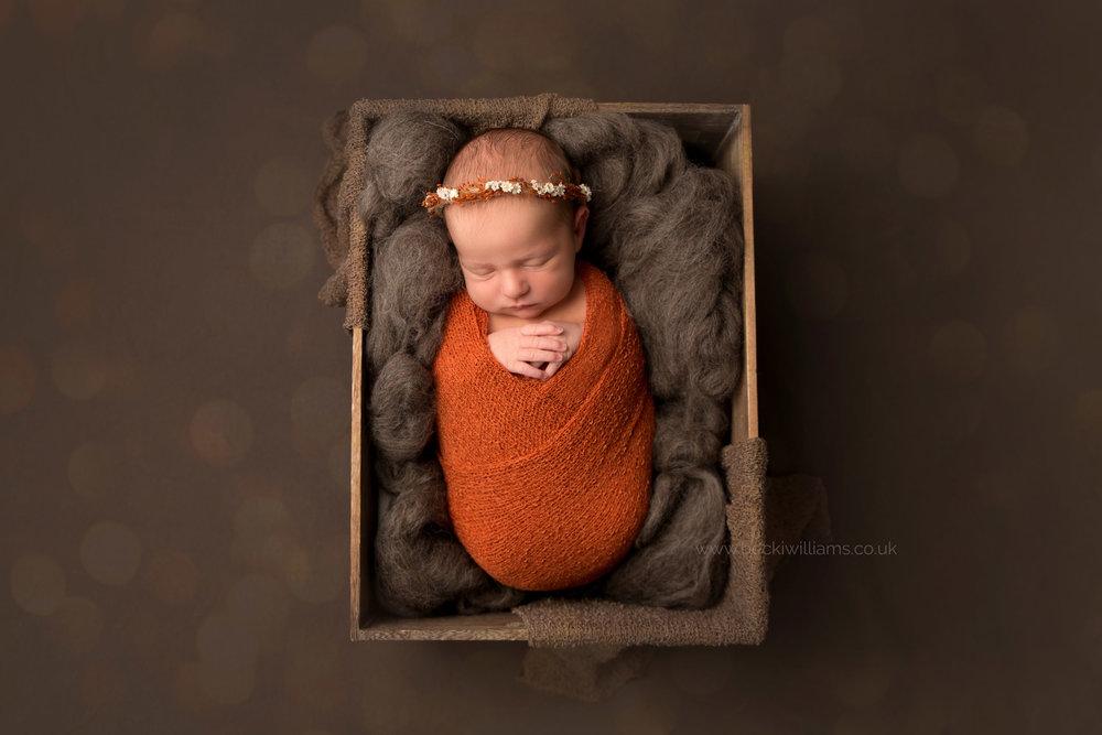 newborn-Hertfordshire-photograher-autumn-posed-asleep-crate-nature.jpg
